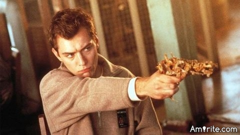 What is your favorite movie weapon?  I was flipping through cable last night and saw the movie Existenz on.  I've always loved this movie...especially the Gristle Gun.  A weapon made from non-edible mutant body parts.