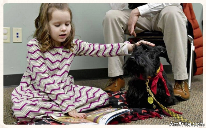 Tail Waggin' Tutors Help Struggling Young Readers Improve Their Reading Skills.